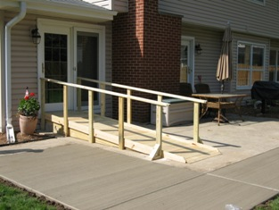 HMI Remodeling-Hoske Maintenance-design, built, installed handicapped ramp to for patio access.