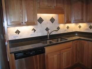 HMI Remodeling-Hoske Maintenance-new cabinet, granite countertops, cermamic backsplash and recessed lighting.
