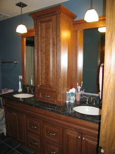 HMI Remodeling-Hoske Maintenance-bathroom room remodeling with custom cabinets, granite top, faucets, tub, toilet and shower, with new mirrors and light fixtures to match design.