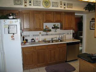 HMI Remodeling-Hoske Maintenance-Installed new cabinets, ceramic tile backsplash and floor and Formica-brand countertops.