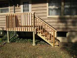 HMI Remodeling-Hoske Maintenance-removed old porch, design and installed new exterior landing and stairs.